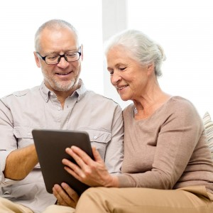 Couple Reading Hearing Resources on Tablet
